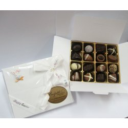 White Easter gift box - 16 chocolates assorted $29.50 PLEASE NOTE EASTER ITEMS ARE SUBJECT TO AVAILABILITY  ORDERING EARLY IS ADVISABLEContains 16 chocolates of your choice see The Menu or a ready made Easter assortment in an Easter decorated white box  Please . Please Click the image for more information.