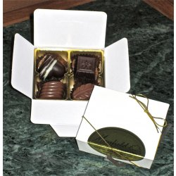 White box - 4 chocolates $9.50 Contains 4 chocolates of your choice see The Menu or a ready made assortment Please indicate your choice in the CARD MESSAGE box which is situated at Step 2 of the order process Eac. Please Click the image for more information.